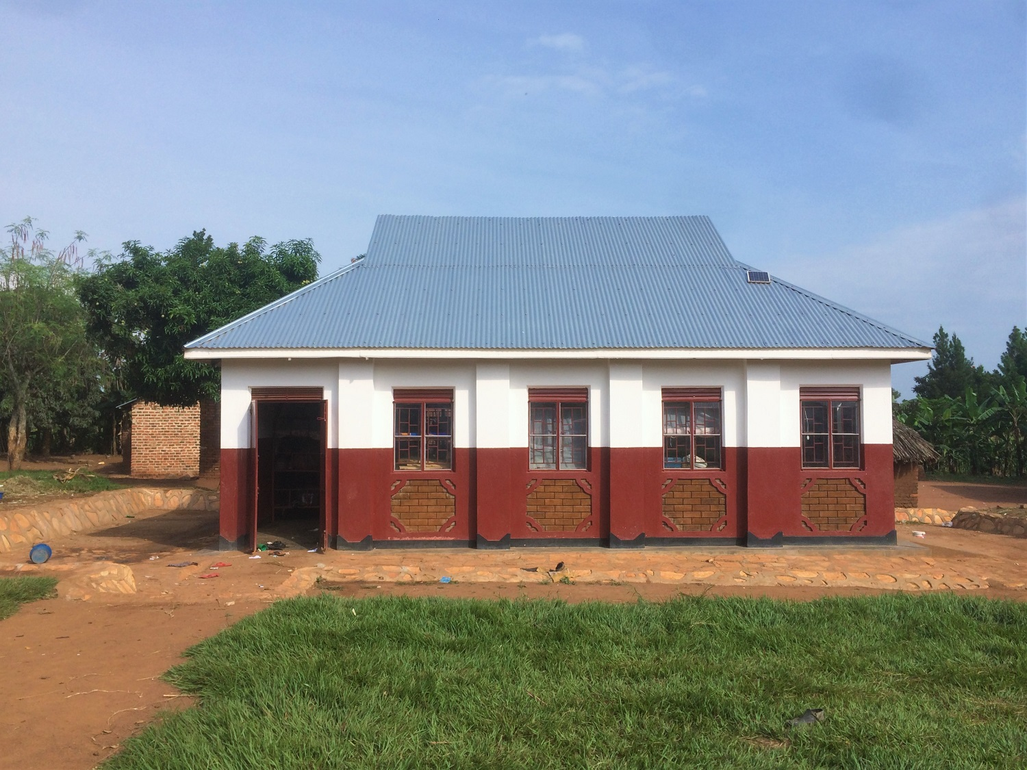 The new girls' dormitory, complete with solar panel for charging.