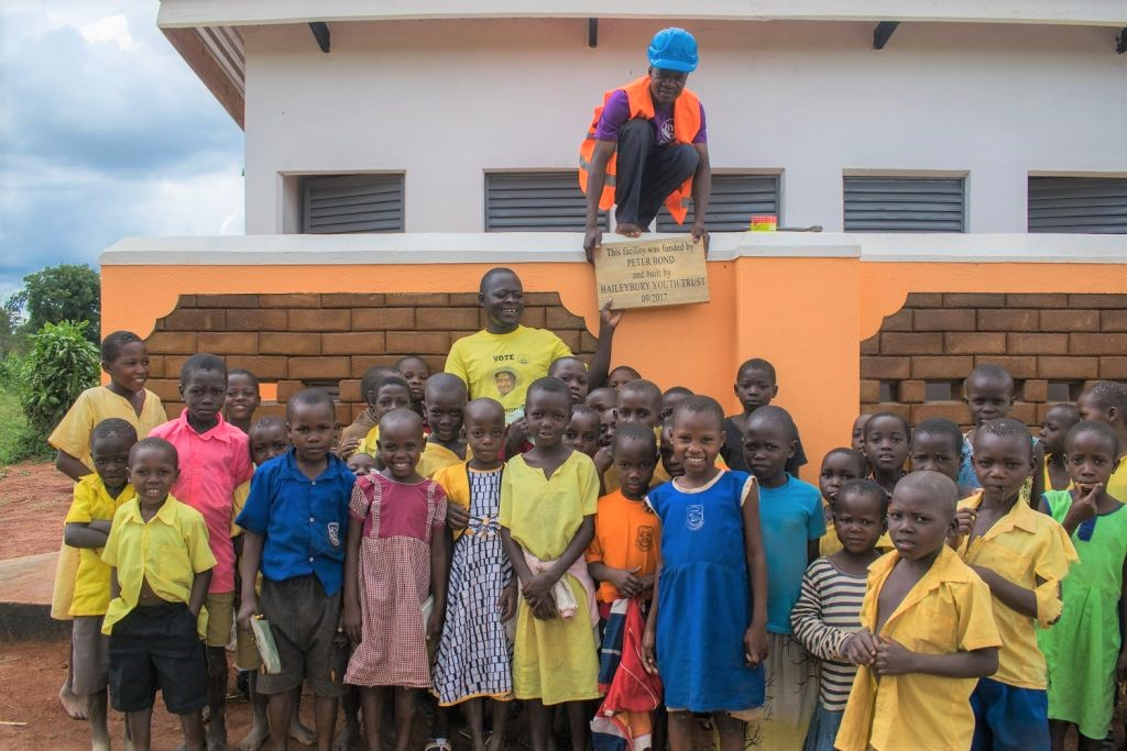 The pupils of RAVO gather to celebrate the opening of the new latrines.