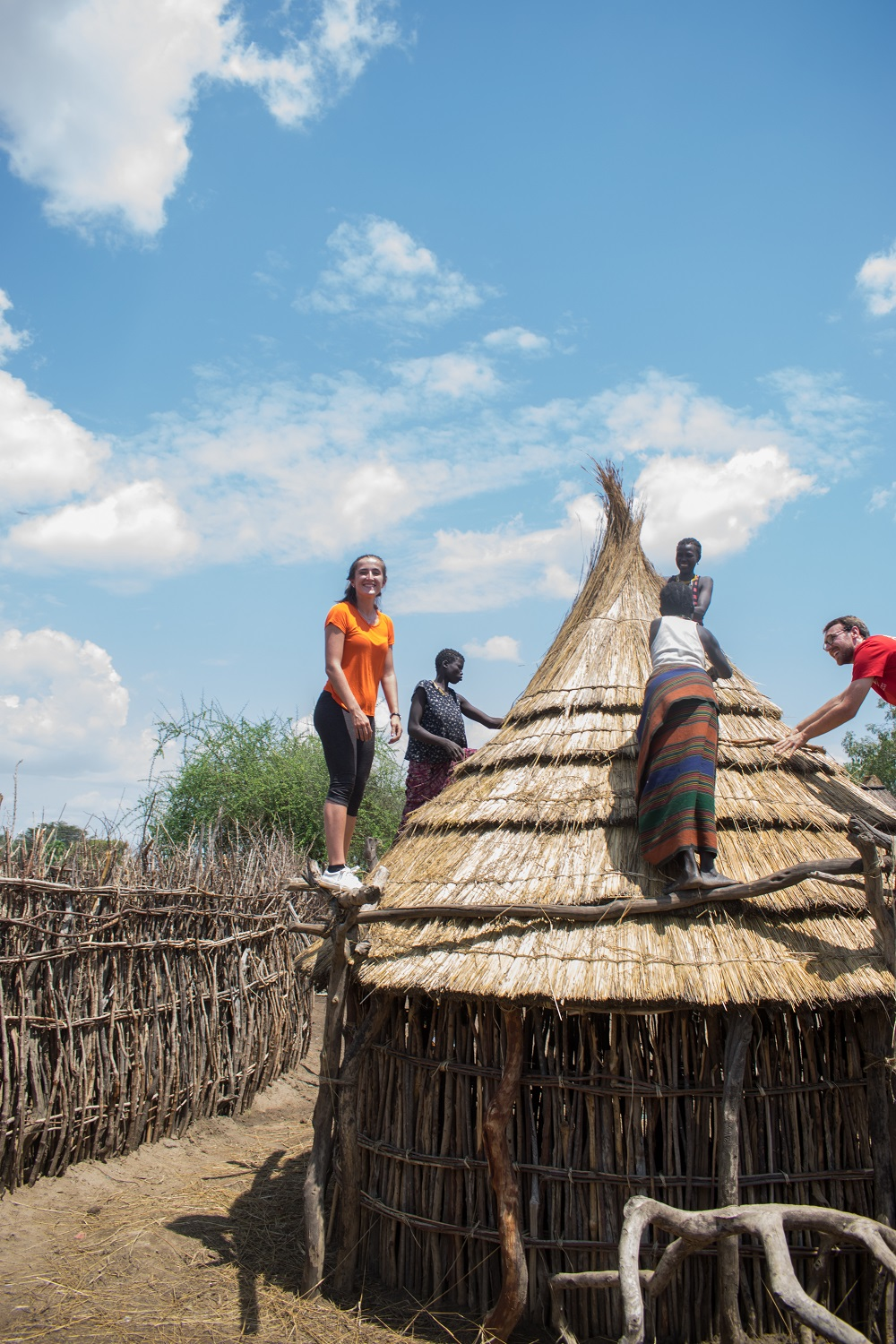 Angelica Pettafor roofs with the Karamojong