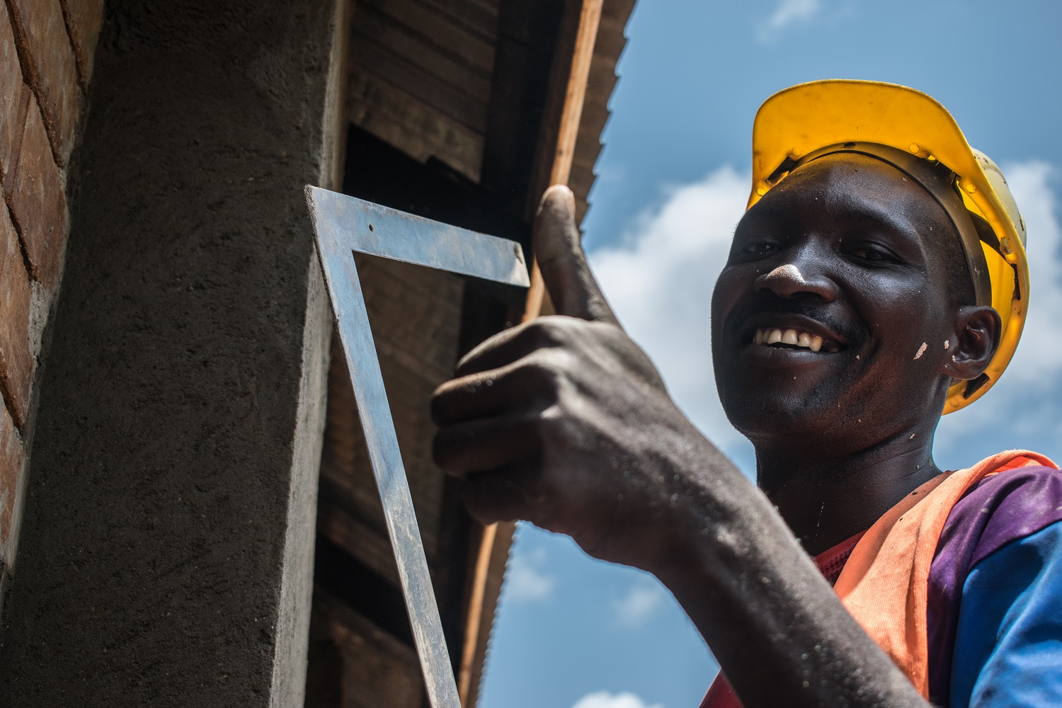 HYT Uganda plastering and set square at Kayembe Primary School