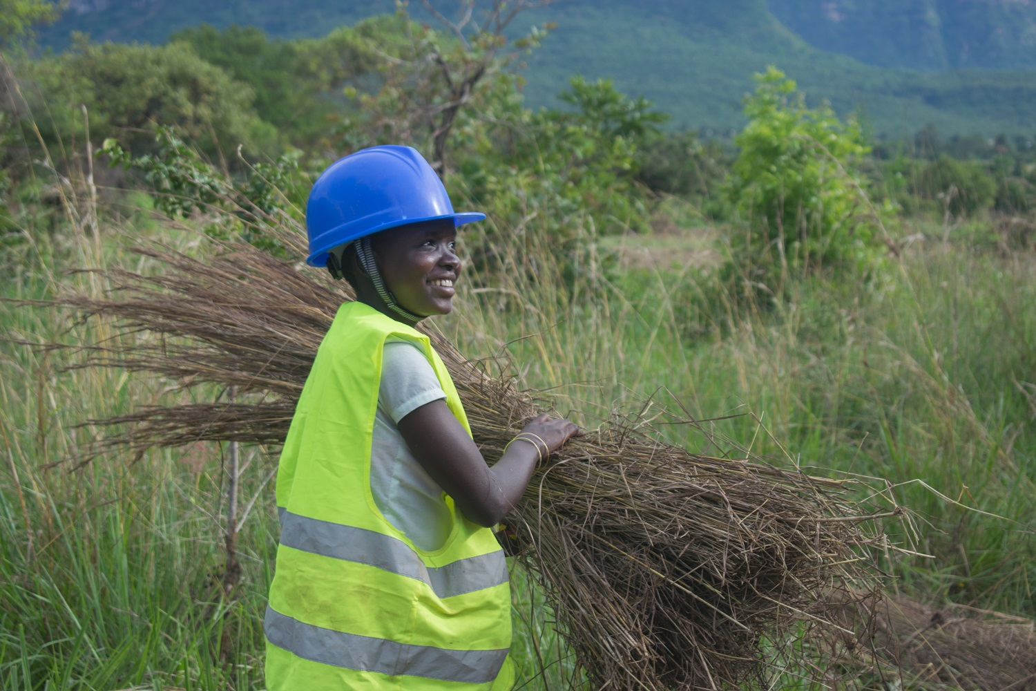 Trainee Roseline Collects Grass at Nakapiripirit