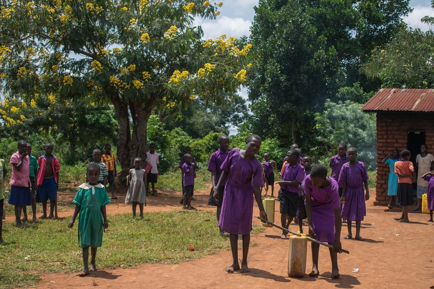 HYT Uganda pupils collect water at Kayembe Primary School